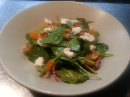 Walton, KY: seasonal salad - organic baby spinach, sun-dried apricots,  toasted English walnuts, Kentucky fa