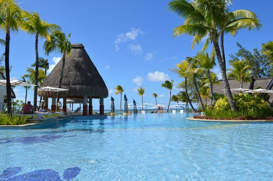 Ambre Mauritius: Pool with beach beyond
