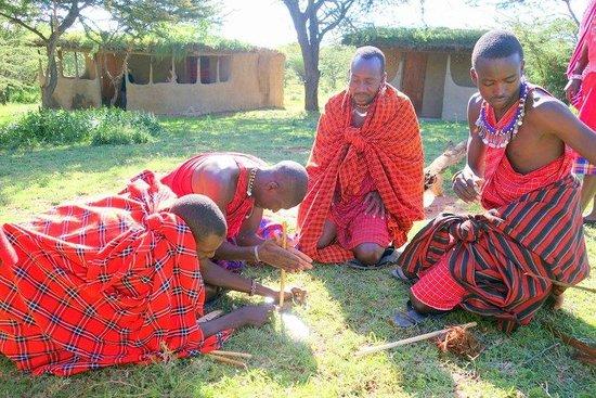 Maji Moto Maasai Cultural Camp : Warrior training for the kids. Making fire.