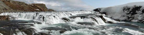 Panorama of the stunning golden waterfall at Gullfoss.