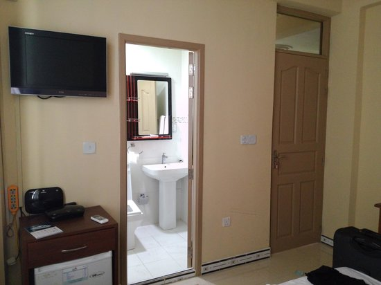Rare Stay: Poorly furnished room, glass pane above entrance offers no privacy