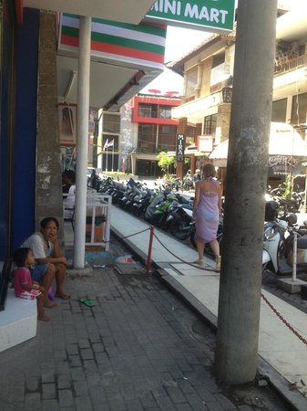 Swiss-Belinn Legian: View of the street from a nearby shop _ the Swiss Belinn is the building at the end