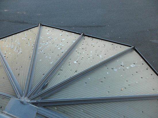 B&B Hôtel Montlucon : View of another entrance to the hotel, (closed) with holes from hail or cigarettes!