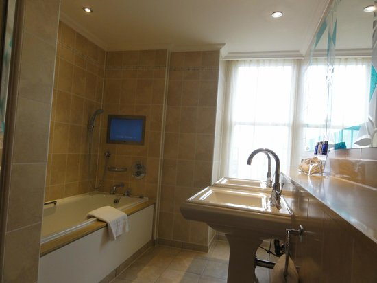 The Royal Horseguards: 745's bathroom, shower out of photo. Double sinks. Tv in bath. Walled mirror. Quality bath produ