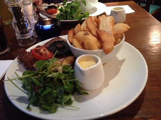 The Royal Oak Hotel: 10 oz Rib Eye, Chips, Watercress Salad with Blue Cheese Sauce. Steak cooked to perfection. Cut l