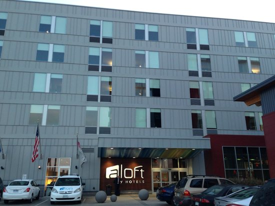 aloft Minneapolis: Close-up of the hotel showing the main entrance, large room windows and modern styling.