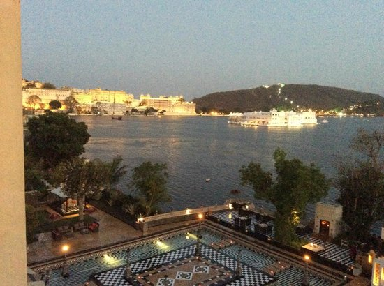 The Leela Palace Udaipur: Partial view from our room overlooking City Palace and Taj Palace Hotel