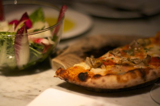 Tozi Restaurant & Bar: Small portions go well. and fast. But you get to try (fit) a lot!