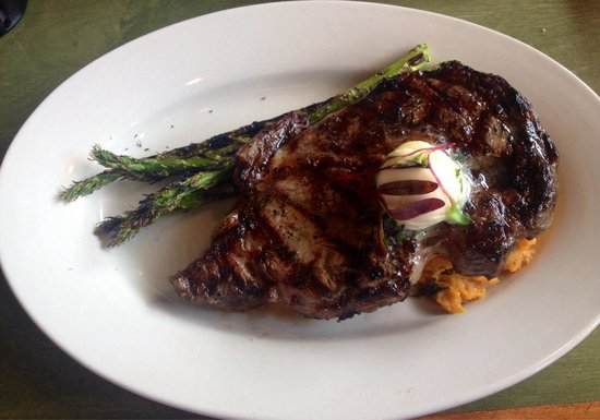 BON TEMPS GRILL : Ribeye with sweet potatoes and asparagus.