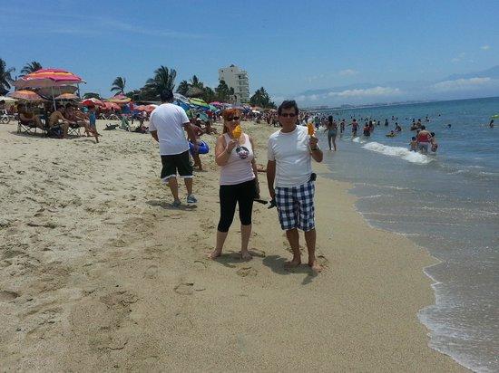 Playa de Nuevo Vallarta: on the beach having a mango on a stick.