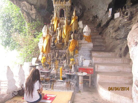 Tham Ting: At prayer in the temple.