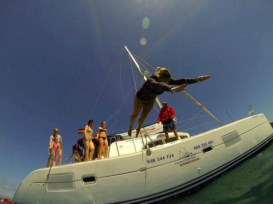 FuerteCharter: Jumping off catamaran at Isla de Lobos