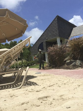 The Westin St. John Resort Villas: gardeners during 1-3pm (prime sun time) steps from our chairs
