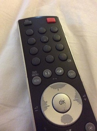 The Luxton Bandung: old condition of remote control in deluxe room