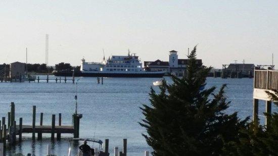 Ocracoke Harbor Inn : Ferry pulling into the harbor.