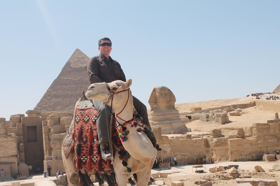 Ramasside Tours - Day Tours: A Life Goal - riding a camel around the pyramids and Great Sphinx