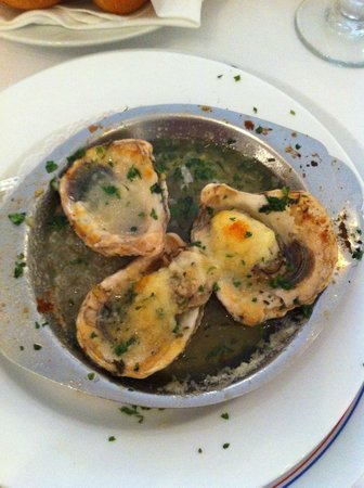 Antoine's char-grilled oyster appetizer