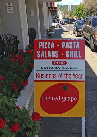 Red Grape Pizzeria: Sign in front of restaurant