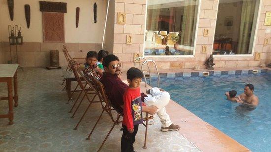 Suryaa Villa: near swimming pool relaxing