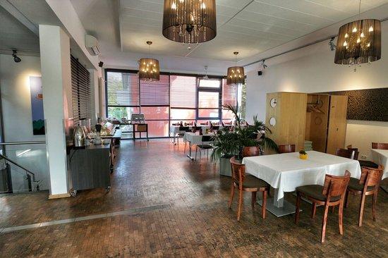 INNdependence Hotel: Restaurant und Frühstücksraum