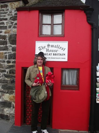 Smallest House in Britain: Wolfie, holding Draco the Dragon (on the left) and Monty his new friend.