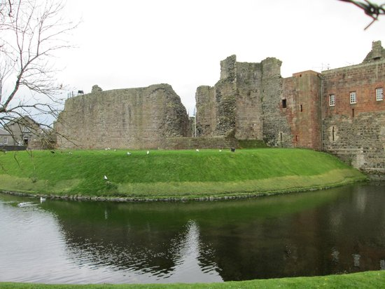rothesay castle on left side of the bridge