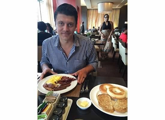 Hyatt Regency Trinidad: My honey enjoying his breakfast.