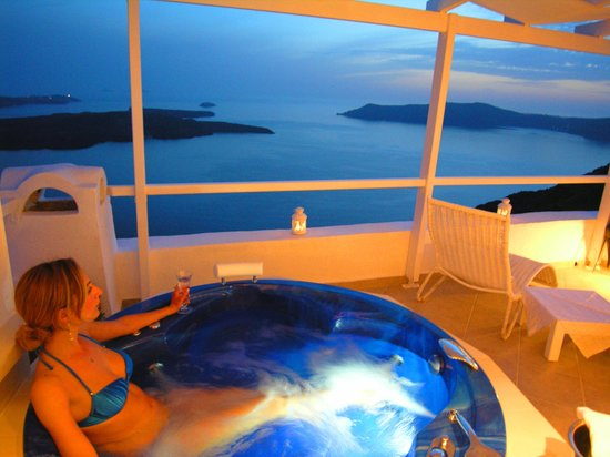 Aeolos Studios & Suites: ANEMOS outdoor jetted tub with sea volcano and sunset view