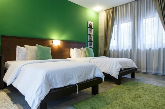 KETAWA Stylish Hotel: Deluxe twin bed room decorated with different colors, moods, and tones
