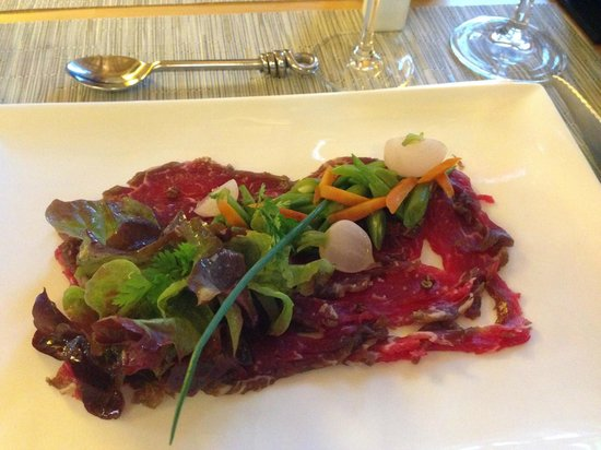 Cap de Castel : Starter - Gravlax style beef Carpaccio with Sichuan pepper and spring vegetables