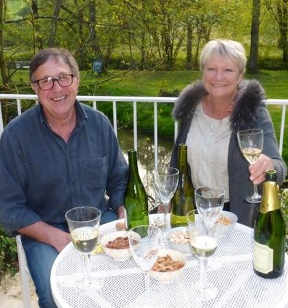 Le Moulin du Mesnil : Owners Jeff and Yvonne enjoying a lovely spring evening!