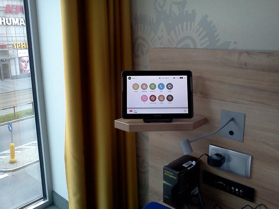 Puro Hotel Kraków: Bedside control system thru Samsung tablet