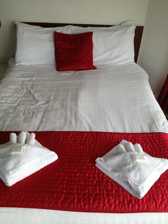 The Kensington Hotel: our bed when we checked in.