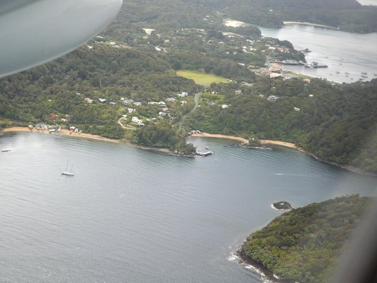 Stewart Island Flights: Golden Bay Wharf, Stewart Is, from plane above