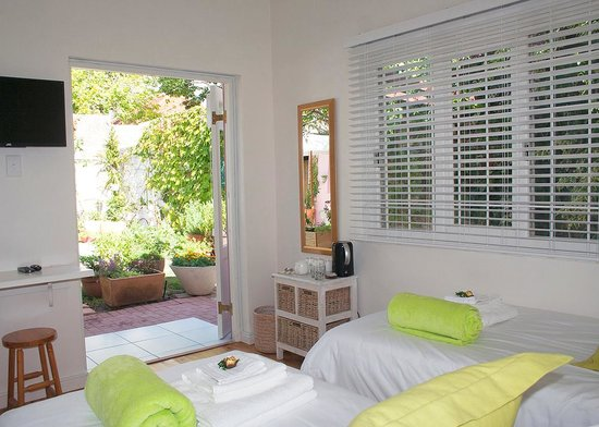 Jaqui's Garden Guesthouse: and Thyme, a beautiful room looking out onto the pool