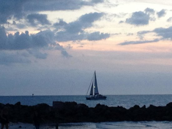 Pelican Pointe Hotel and Resort: Sailboat at sunset- April 2014