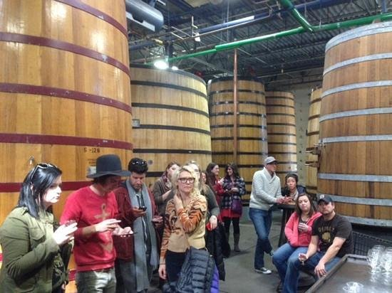 New Belgium Brewing: Sampling aged sour beer, behind us are the barrels they age in.