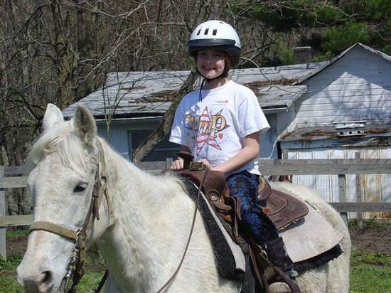 Equestrian Adventures: My daughter is thrilled to be going on her very first horse ride.