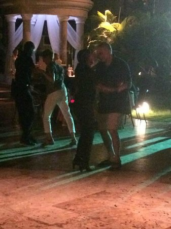 Dreams Palm Beach Punta Cana: My husband dancing with an entertainment staff member