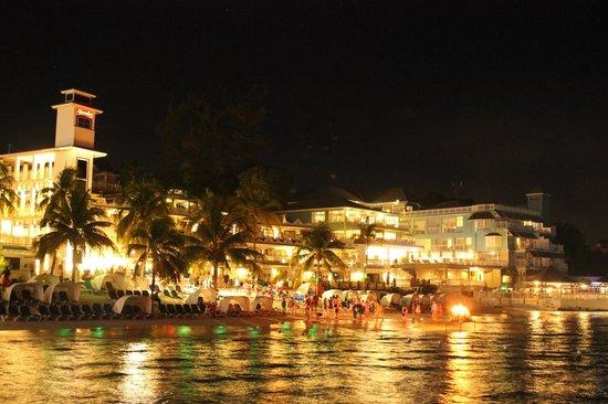 Beaches Ocho Rios Resort & Golf Club : Resort from the dock - lit up at night.