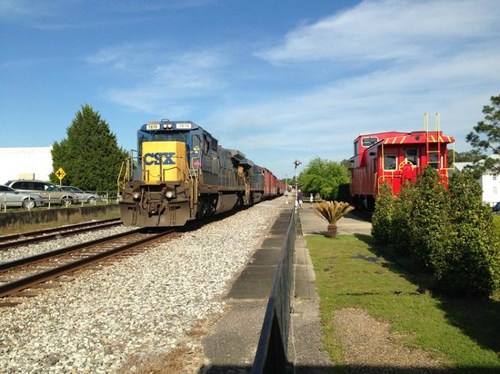DeFuniak Springs, FL: Real freight train passing the historic DeFuniak railroad depot makes it even more special!