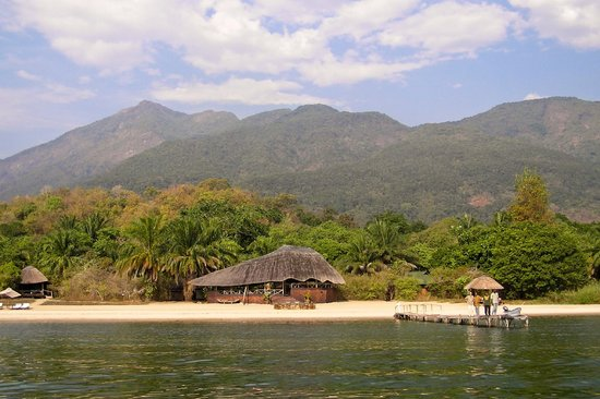 Kungwe Beach Lodge: View of resort from boat approach