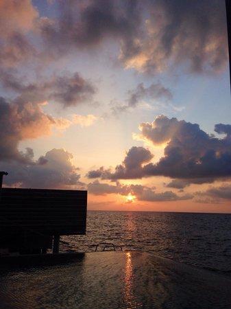 Dusit Thani Maldives: Sunset from villa deck