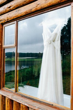 Stanford Lake Lodge: View of the dress hanging in the window of the double-storey log cabin