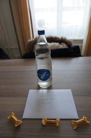 EMA House Hotel Suites: warm welcome letter with bottle of water and chocolates