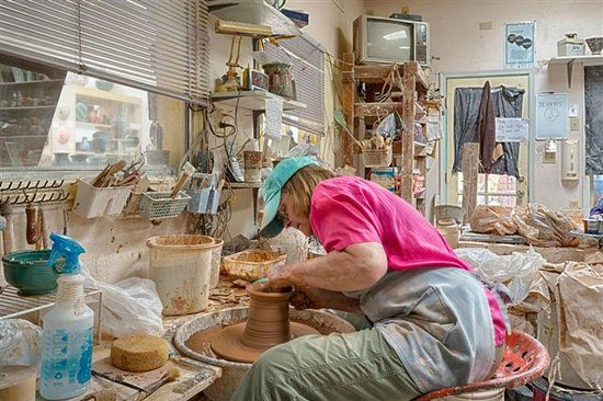 Clay Hands Gallery & Studio: Diane creating pottery.
