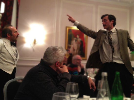 Faulty Towers the Dining Experience: Manuel gets Torquay Hotel training.