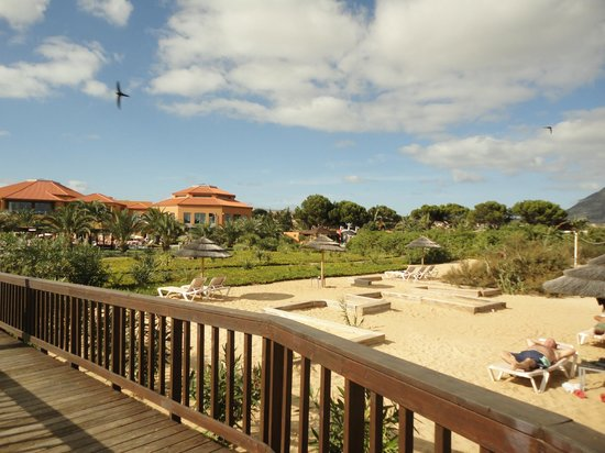 Pestana Porto Santo All Inclusive : Beach loungers cut into dunes and view back to hotel