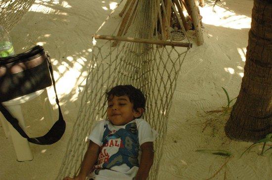 Stingray Beach Inn : My son Fiam on the hammock