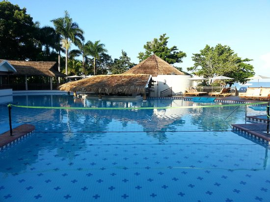 Beaches Negril Resort & Spa: main pool volleyball area looking towards the bar
